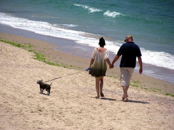 Mediterranean Sea-Beach-couple walk hand in hand
