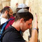 Jewish-men-praying-Western-Wall-Kotel