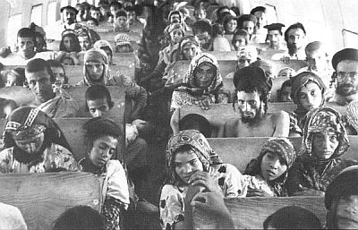 """Yemenite Jews on their way to Israel in one of the planes that carried them home """"on eagle's wings."""" (Isaiah 40:31)"""