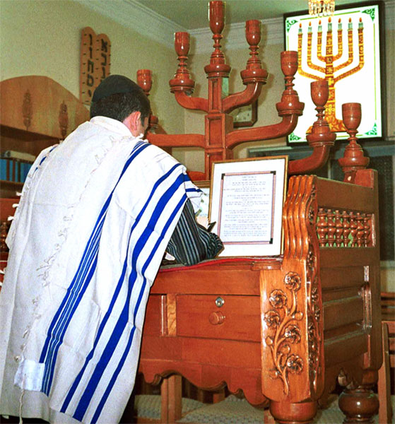 An Iranian Jew prays in a synagogue in Shiraz, Iran.