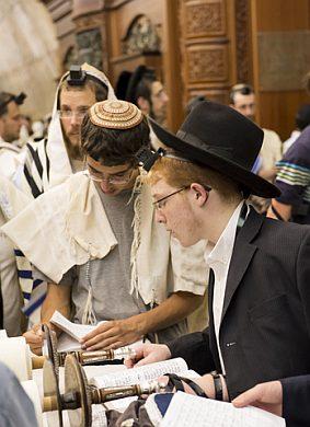 Young-Jewish-men-read-Torah-scrolls-Western-Wall-Jerusalem