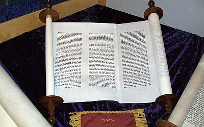 An open scroll of Job on display in a museum