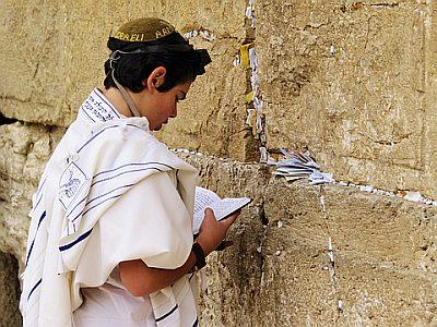 Bar mitzvah boy praying at the Wall
