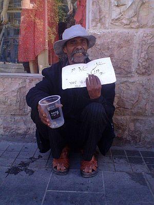 A beggar on Jaffa Street in Jerusalem