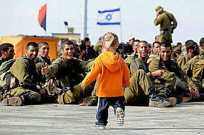 Israel Defense Forces soldiers welcome a child in their midst