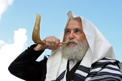 Jewish man blows the Shofar