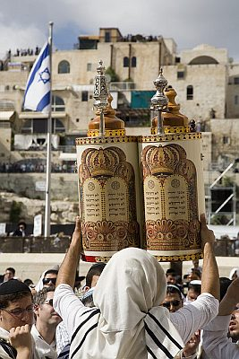 Lifting the Sefer Torah tik in Jerusalem so all can see the Holy Scripture contained on the scroll that is protected inside.