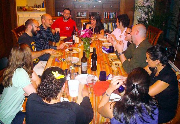 family-friends-talk-Shabbat-dinner