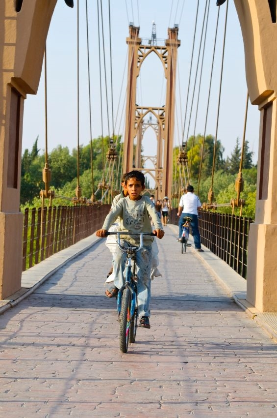 Syrian children-bicycle-Euphrates River-Deir ez-Zor-bridge