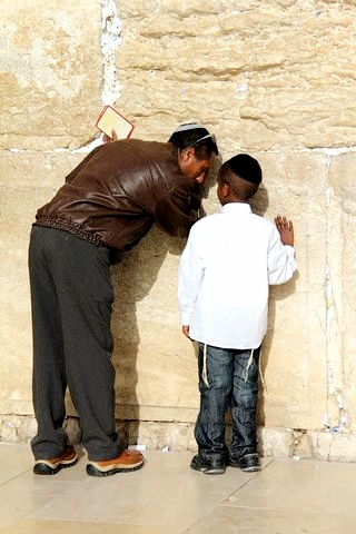 Father-son-pray-Kotel