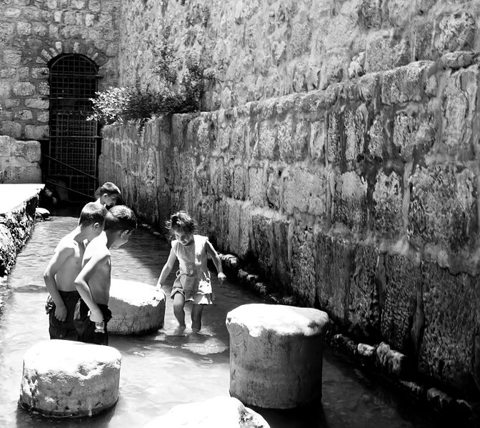 Children playing in the Pool of Siloam in Jerusalem