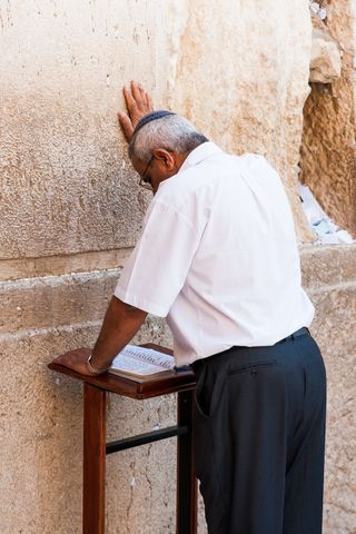 Kippah wearing man-prays-Western Wall