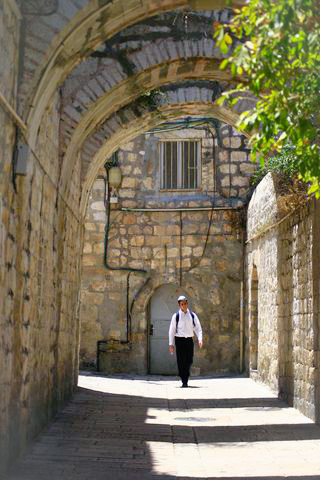 Religious Jew-Walks-Street-Old City-Jerusalem