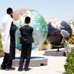 Orthodox father-children-world map-globe