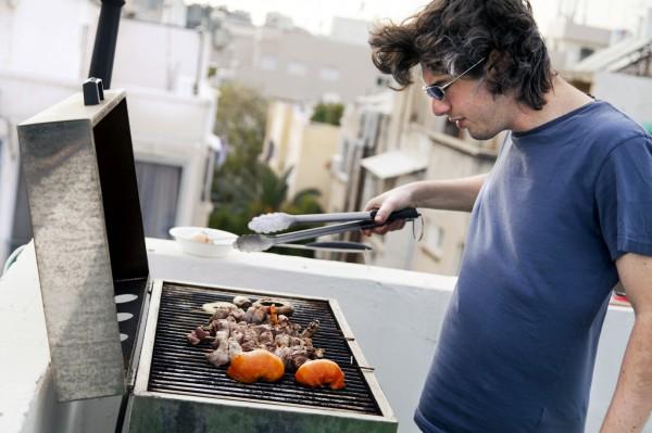 Israeli man-barbequing-rooftop