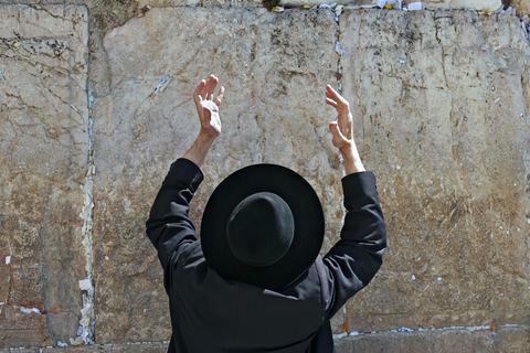 Ultra-Orthodox man-lifting hands-prayer-Kotel-Western Wall