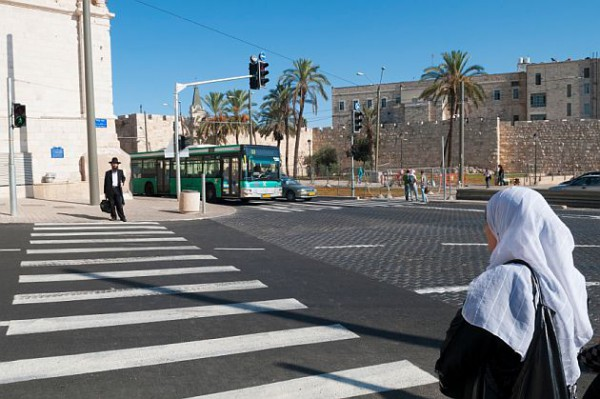 Jewish-man-Arab-woman-crosswalk-in-Jerusalem
