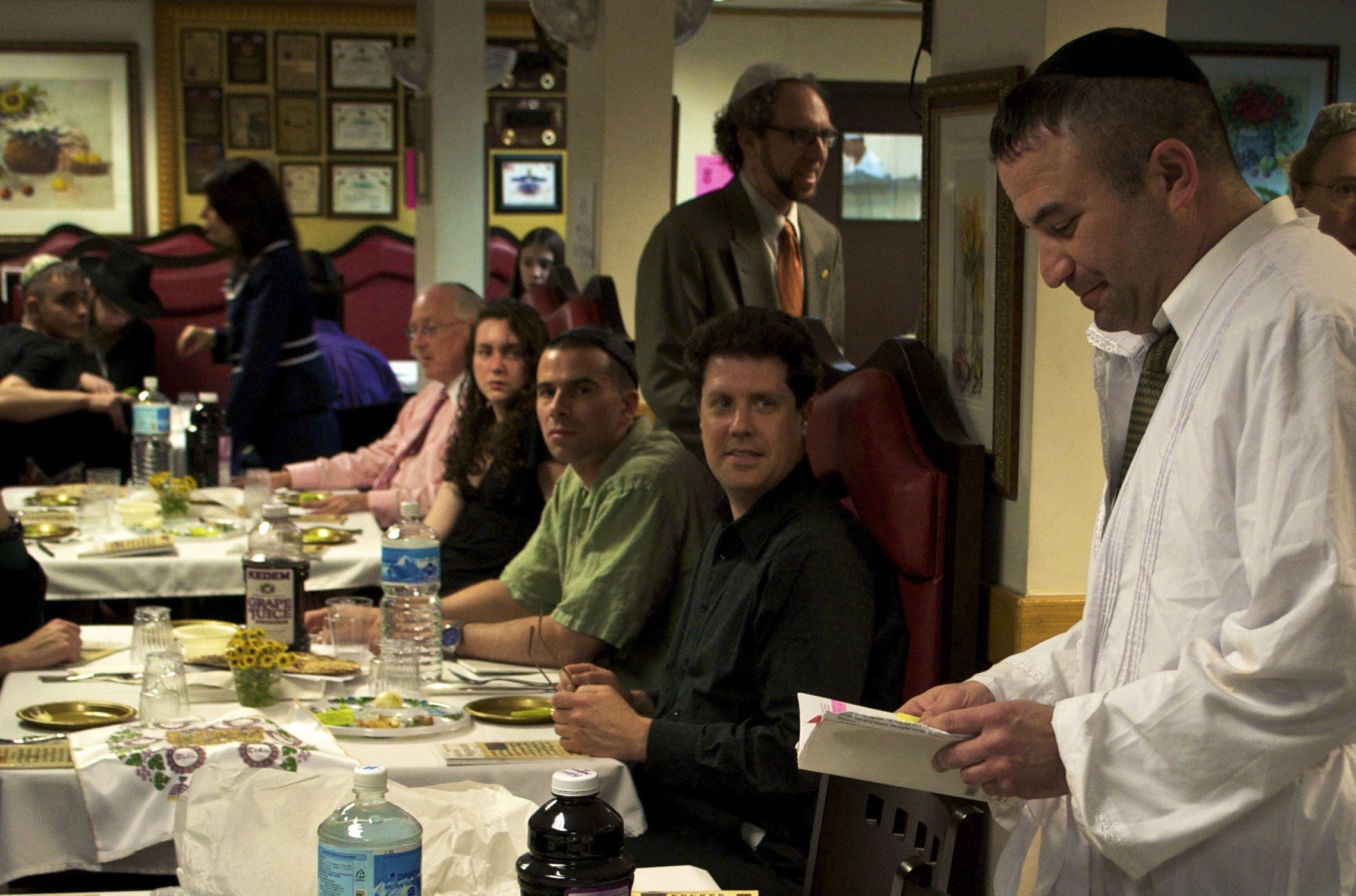 A Jewish man reads from the Haggadah during the Passover Seder.