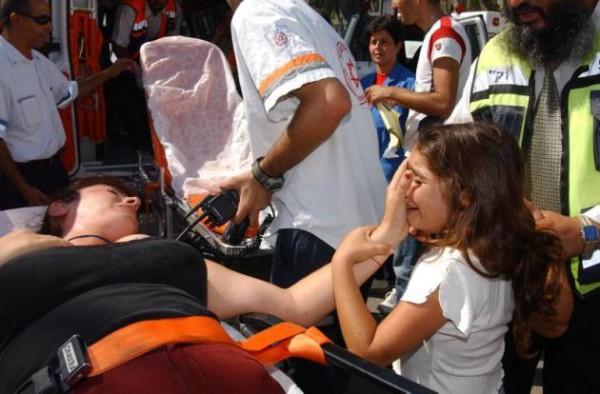 Sderot-injured mother-upset Israeli child-Gazan rocket attack