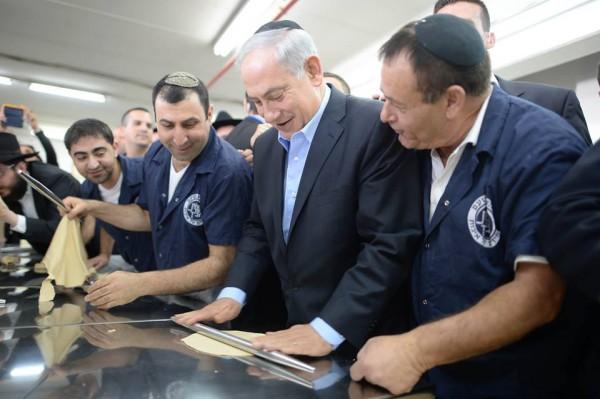 Prime Minister Benjamin Netanyahu learns how to make kosher-for-Passover matzah.