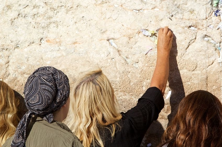 Jewish women pray at the Western (Wailing) Wall in Jerusalem.  To keep the peace with Muslims, Jews are currently forbidden to pray on the Temple Mount, Judaism's holiest site.  The Western Wall is part of the wall that once surrounded the ancient Temple's courtyard, and is therefore, considered Judaism's second holiest site.