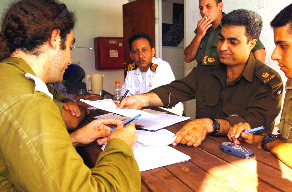 Israeli and Palestinian officers hold a field situation assessment in preparation for Israel's 2005 Gaza Disengagement.
