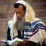 Orthodox Jewish man in prayer-tallit-tefillin