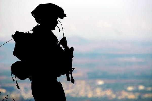 An IDF soldier stands guard at a military base in the Golan Heights.