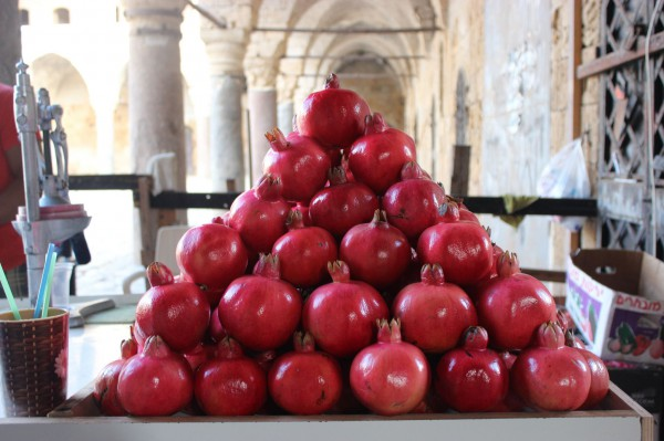 A juice stand in Israel with a tantalizing display of pomegranates.