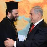 Israeli Prime Minister Benjamin Netanyahu greets Father Nadaf.