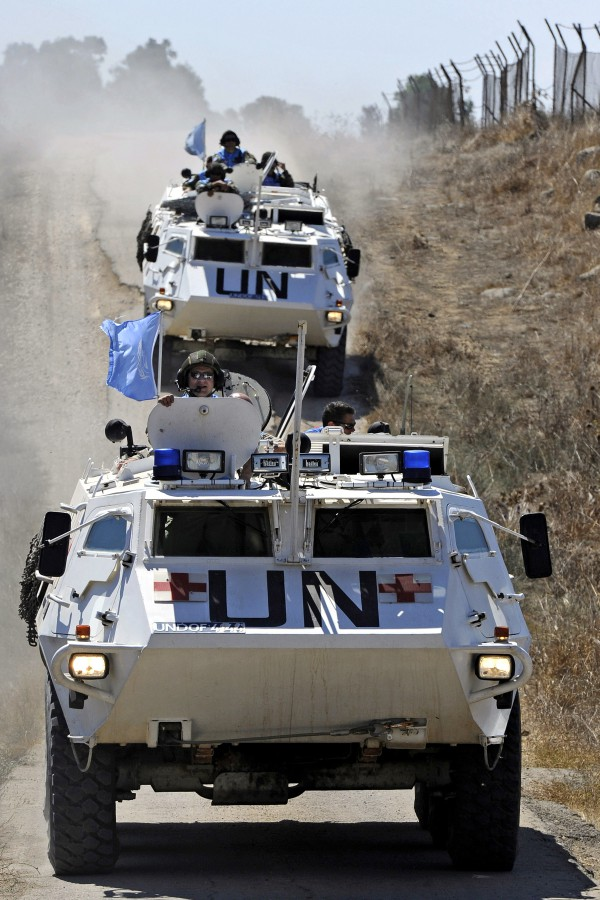 Armored personnel carriers of the UN Disengagement observer Force (UNDOF) on command patrol in the Golan Heights.