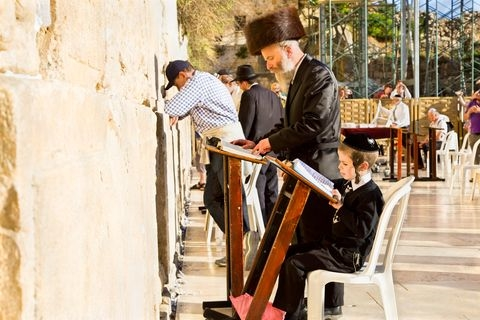 Jewish men and children pray at the Western (Wailing) Wall in the Old City of Jerusalem.