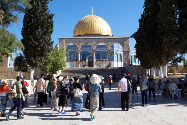 Tourists visit the Temple Mount where the First and Second Temples were located in Jerusalem.  Currently, the Dome of the Rock occupies the spot where the ancient Temple once stood.