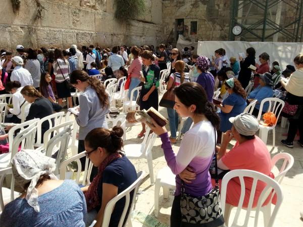 Jewish women pray at the Western Wall on Sukkot.