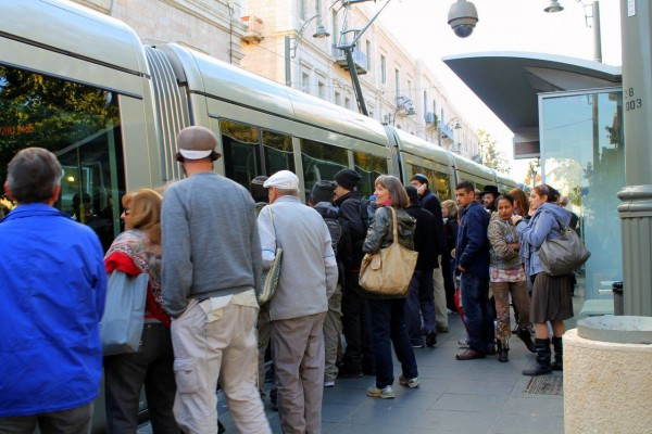 A crowded light rail station in Jerusalem.