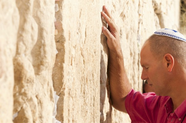 A Jewish man prays at the Western (Wailing) Wall.