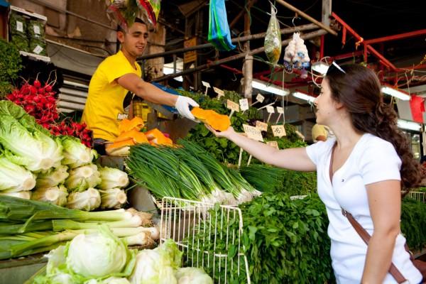 A Jewish woman shops in Tel Aviv's Carmel Market (Photo by Dana Friedlander / Go Israel)
