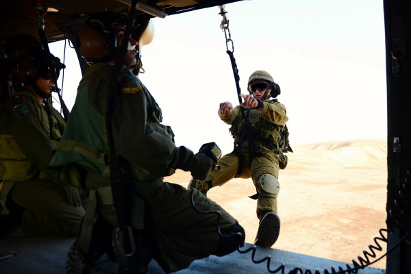 IDF's Nahal Brigade and elite rescuers from the Airborne Rescue and Evacuation Unit 669 soldiers embark on a helicopter mission exercise. (IDF photo by Pvt. Alexi Rosenfeld)