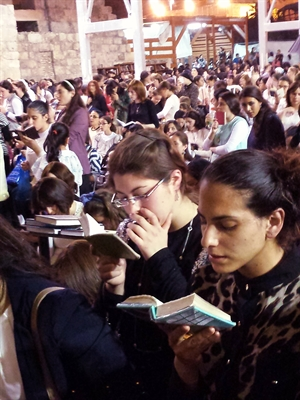 Jewish women pray in the Women's Section of the Western Wall.