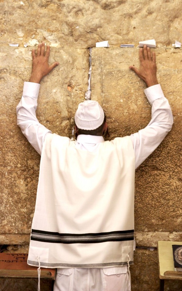 A Jewish man prays at the Western (Wailing) Wall in Jerusalem. (Photo by Lev Cap)