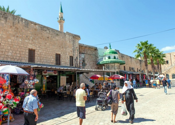 People of many ethnicities on a street in Acre, Israel