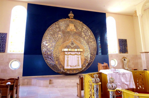 The Aron Kodesh (Torah Ark), which is today a comparative to the Ark of the Covenant, hangs above the bimah (platform) of the Geulat Moshe Synagogue in Tel Aviv, Israel.