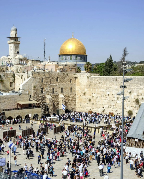 Jewish pilgrims visit the Western (Wailing) Wall during Passover. On the Temple Mount, the Muslim Dome of the Rock occupies the spot where the Holy of Holies once stood.
