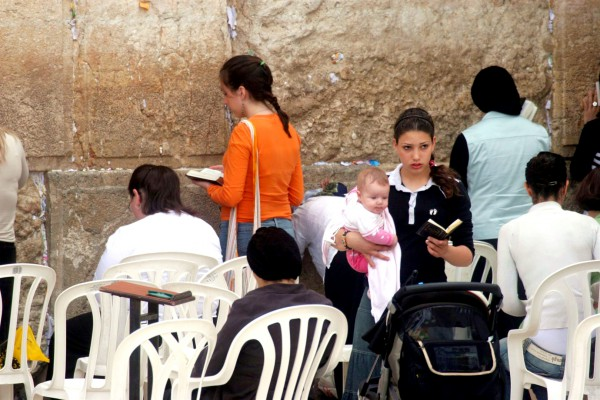Women are not permitted to wear tallitot at the Western Wall.