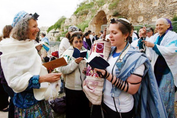 Women of the Wall praying and reading Torah at their monthly Rosh Chodesh (new moon, literally head of the new [month]) service.