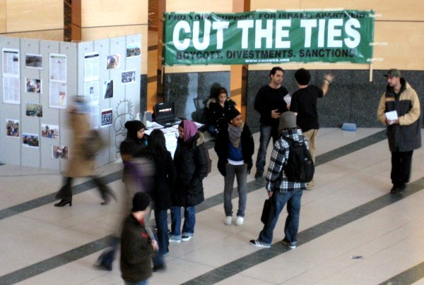 """A banner at Toronto's York University in Toronto tells passersby to end their """"support for Israeli Apartheid: cut the ties: boycott, divestments, sanctions."""""""
