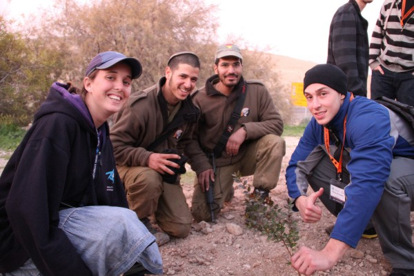 A group of American Jews visiting Israel plant trees together with IDF soldiers on Tu B'shvat.