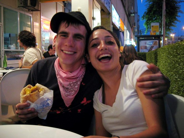 A couple has a bite to eat in Tel Aviv.