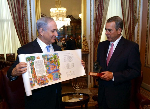 Prime Minister Benjamin Netanyahu presents House Speaker John Boehner with a scroll of the Book of Esther. Boehner presents him with a bust of Winston Churchill because Churchill and Netanyahu are the only foreign leaders who have addressed Congress three separate times. (GPO photo by Amos Ben Gershom)