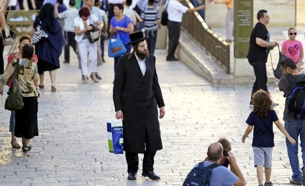 An ultra-Orthodox Jewish man on his way to pray at the Kotel (Western Wall).